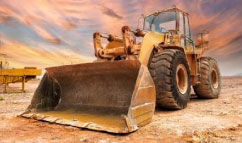 Bulldozer in the dirty road