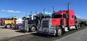 line of big trucks and trailer machines